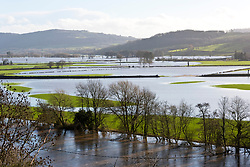 © Licensed to London News Pictures. 19/12/2020. Whitney-on-Wye, Herefordshire, UK. The river Wye breaks it's banks at Whitney-on-Wye, in Herefordshire, UK. Photo credit: Graham M. Lawrence/LNP