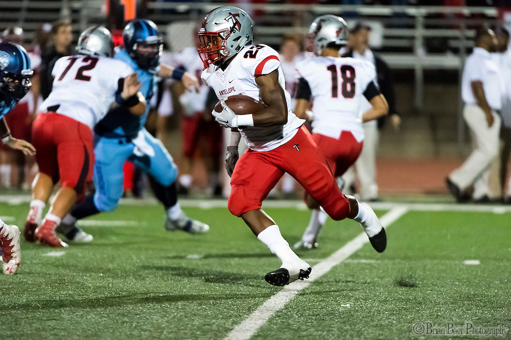 Antelope High School Titans Elijah Dotson (23), runs with the ball during the first quarter as the Oakmont High School Vikings host the Antelope High School Titans Friday Sep 30, 2016.<br /> photo by Brian Baer