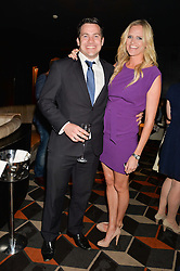 EMMA SAYLE and JAMES TINDALL  at a party to celebrate the publication of Behind The Mask by Emma Sayle held at The Playboy Club, 14 Old Park Lane, London on 23rd April 2014.