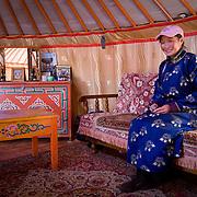 Mongolian woman inside traditional ger tent (Gorkhi-Terelj national park, Mongolia - Sep. 2008) (Image ID: 080917-0923472a)