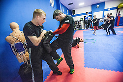 Students kneeing and punching as Stef Noij, KMG Instructor from the Institute Krav Maga Netherlands, takes the IKMS G Level Programme seminar today at the Scottish Martial Arts Centre, Alloa.