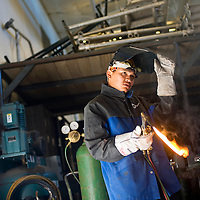 021213       Brian Leddy<br /> Therman Thomas prepares to practice welding in his beginning welding class at Navajo Technical College Tuesday. The school has over 60 students in the Construction Technology program.
