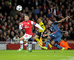 Arsenal's Alex Oxlade-Chamberlain gets the better of Bayern Munich's David Alaba but fails to beat Bayern Munich's Manuel Neuer to the ball - Photo mandatory by-line: Joe Meredith/JMP - Tel: Mobile: 07966 386802 19/02/2014 - SPORT - FOOTBALL - London - Emirates Stadium - Arsenal v Bayern Munich - Champions League - Last 16 - First Leg