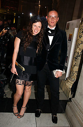 KATIE GRAND and GILES DEACON at the British Fashion Awards 2006 sponsored by Swarovski held at the V&A Museum, Cromwell Road, London SW7 on 2nd November 2006.<br /><br />NON EXCLUSIVE - WORLD RIGHTS