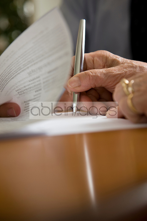 Close up of woman hands signing documents