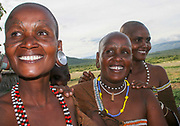 Women of the Datooga tribe in traditional dress, beads and earrings Beauty scarring can be seen around the eyes, Photographed in Lake Eyasi Tanzania