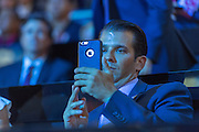 Don Trump, Jr., son of GOP Presidential candidate Donald Trump uses his phone to take a video after Senator Ted Cruz was rushed off stage by dimming the lights during his addresses on the third day of the Republican National Convention July 20, 2016 in Cleveland, Ohio. Cruz refused to endorse candidate Donald Trump.