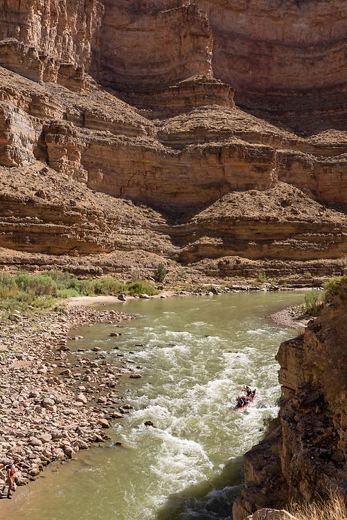 Canoeists running Ross Rapid on the San Juan River, Utah.