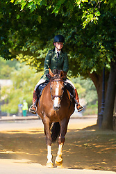 A woman in formal horse riding attire ignores the heat in Hyde Park as another heatwave day begins with temperatures expected to soar. London, July 01 2018.
