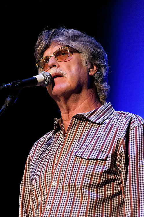 Keyboardist, Bob Carpenter, on primary vocals during the Nitty Gritty Dirt Band's performance at the Landis Theater in Vineland, NJ.