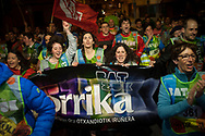 """People run on the 20th Korrika. Tutera (Basque Country). April 1, 2017. The """"Korrika"""" is a relay course, with a wooden baton that passes from hand to hand without interruption, organised every two years in a bid to promote the basque language. The Korrika runs over 11 days and 10 nights, crossing many Basque villages and cities. This year was the 20th edition and run more than 2500 Kilometres. Some people consider it an honour to carry the baton with the symbol of the Basques, """"buying"""" kilometres to support Basque language teaching. (Gari Garaialde / Bostok Photo)"""