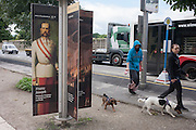 Austrian Emperor Franz Josef and modern day dog walkers outside Schloss Schonbrunn, in Vienna, Austria, EU.
