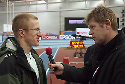 Slovenian athlete Matic Osovnikar interviewed by journalist of Radio Slovenia Boris Licof at warming up day before European Athletics Indoor Championships Torino 2009 (6th - 8th March), at Oval Lingotto Stadium,  Torino, Italy, on March 5, 2009. (Photo by Vid Ponikvar / Sportida)