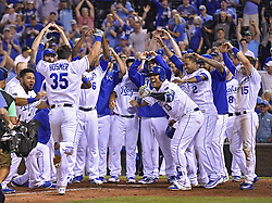 August 23, 2017 - Kansas City, MO, USA - The Kansas City Royals' Eric Hosmer is greeted at home plate by the team after his game-winning walk-off home run in the ninth inning against the Colorado Rockies at Kauffman Stadium in Kansas City, Mo., on Wednesday, Aug. 23, 2017. The Royals won, 6-4. (Credit Image: © John Sleezer/TNS via ZUMA Wire)