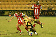 Exeters Harry Kite and Harrogates Jack Muldoon battle for the ball during the EFL Sky Bet League 2 match between Harrogate Town and Exeter City at the EnviroVent Stadium, Harrogate, United Kingdom on 19 January 2021.
