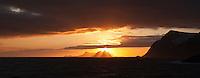 Winter sun sets over Væeroy island viewed from near Å, Lofoten Islands, Norway