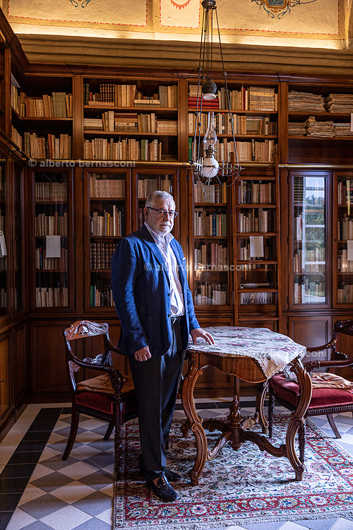 """Damilne, Bergamo, Doctor Eugenio Poletti, in his historical house. Eugenio Poletti de Chaurand, a surgeon at Pope John XXIII Hospital, contracted the coronavirus in March and spent eight days using an oxygen helmet. He knew he needed the support — """"I could feel myself suffocating,"""" he said — but he grew so agitated that he tried again and again to remove it. Doctors sedated him. He's made almost a full recovery and returned to work in mid-May. RIGHT: Poletti de Chaurand said he has """"only one lingering consequence"""" from his fight with the disease — a sensation, both strange and marvelous, that can suddenly overwhelm him, even during surgeries. In those moments, he becomes acutely aware of his lungs at work. """"I draw deep breaths,"""" he said, """"and feel great relief."""""""