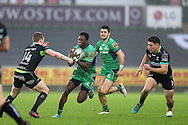 Niyi Adeolokun of Connacht Rugby © tries to break past Dafydd Howells of Ospreys (l). Guinness Pro12 rugby match, Ospreys v Connacht rugby at the Liberty Stadium in Swansea, South Wales on Saturday 7th January 2017.<br /> pic by Andrew Orchard, Andrew Orchard sports photography.