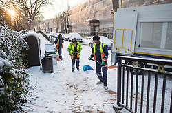 © Licensed to London News Pictures. 28/02/2018. London, UK. Council workers spread grit on the pavements at sunrise in Little Venice, West London following heavy snowfall last night. Large parts of the UK are experiencing disruption as 'Storm Emma' hits, following Russian a cold front earlier in the week named 'The Beast From The East'. Photo credit: Ben Cawthra/LNP