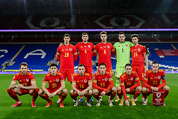 CARDIFF, WALES - Wednesday, November 18, 2020: Wales players line-up for a team group photograph before the UEFA Nations League Group Stage League B Group 4 match between Wales and Finland at the Cardiff City Stadium. Back row L-R: James Lawrence, Chris Mepham, Joe Rodon, goalkeeper Daniel Ward, Ethan Ampadu. Front row L-R: Rhys Norrington-Davies, Daniel James, Joseff Morrell, Harry Wilson, Connor Roberts, captain Gareth Bale. (Handout/FAW)