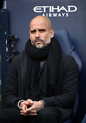 Manchester City manager Pep Guardiola sat in the dugout during the Premier League match at the Etihad Stadium, Manchester.