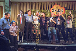 © Licensed to London News Pictures . 08/10/2014 . Glasgow , UK . PADDY ASHDOWN (2nd from right) joins delegates with a cardboard cutout of Nick Clegg to sing and dance on the stage . Glee club fringe event overnight at the conference hotel . The Liberal Democrat Party Conference 2014 at the Scottish Exhibition and Conference Centre in Glasgow . Photo credit : Joel Goodman/LNP