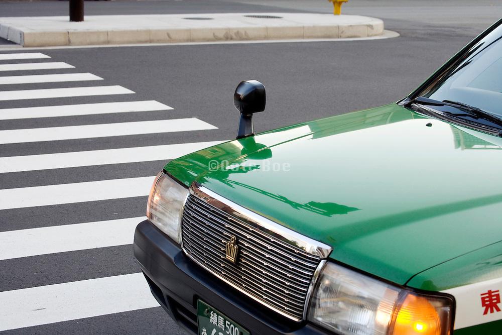 Japanese taxi crosses a zebra crossing Tokyo Japan