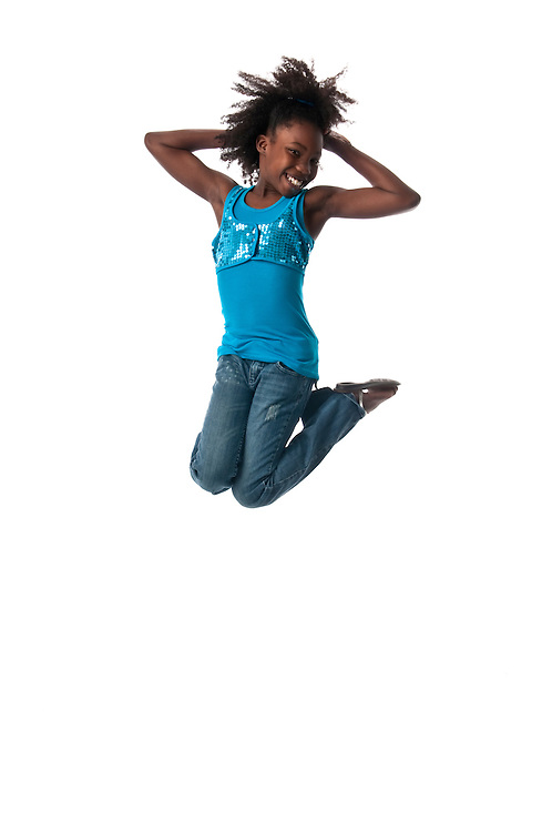 African american girl jumping very high and happy.