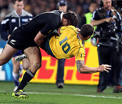 © Andrew Fosker / Seconds Left Images 2011 - New Zealand's Richard Kahui takes out Australia's Quade Cooper with a massive tackle -  Australia v New Zealand - Rugby World Cup 2011 - Semi Final - Eden Park - Auckland - New Zealand - 16/10/2011 -  All rights reserved..