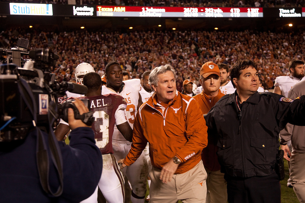 Mack Brown, head coach. Texas Longhorns at Texas A&M Aggies. Photographed at Kyle Field in College Station, Texas on Thursday, November 26 2009. Photograph © 2009 Darren Carroll