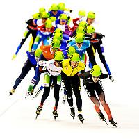 The Netherlands, Heerenveen, 02-11-2014.<br /> Speedskating, Dutch National Championships Distances.<br /> Mass start, Men.                  <br /> Sven Kramer, speedskater of the Lotto Jumbo team, in front of the peleton in the yellow jersey.<br /> Photo : Klaas Jan van der Weij