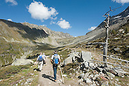Hiking in the Ortler area of the Stelvio National Park, near the small mountain town of Solda. Vinschgau region, South Tyrol, Italy. Mt Ortles (3905m) is the highest mountain in the Eastern Alps. Hikers approaching Rifugio Serristori (Dusseldorferhutte). © Rudolf Abraham