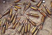 """Abandoned bullets in the sand by the Jahra Road from Kuwait City to Basra, Iraq. American forces chased and trapped retreating Iraqi forces north of Kuwait City on the night of February 25 and the day of February 26, 1991. These units withdrew via the Jahra road on the way to Basra, an escape route that has become known as the """"highway to hell."""" They were attacked by coalition aircraft and it is estimated that several thousand retreating Iraqis died.."""