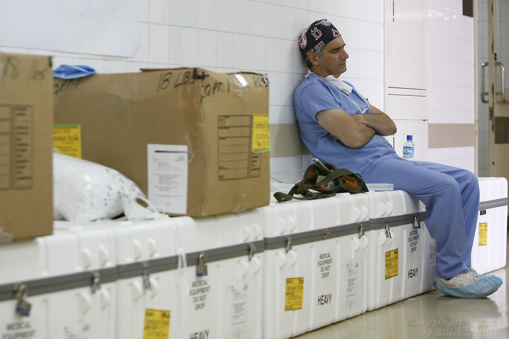 Plastic Surgeon Michael Boyajian, from Maryland, rests for a moment during surgery week at the Hospital Japones in Santa Cruz, Bolivia on November 14, 2007, during Operation Smile's World Journey of Smiles. ..Photograph by Erin Lubin
