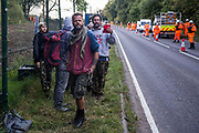 Activists opposed to the HS2 high-speed rail link monitor an operation by National Eviction Team NET enforcement agents to remove fellow activists from Wendover Active Resistance WAR camp on 10th October 2021 in Wendover, United Kingdom. WAR camp, which contains tree houses, tunnels, a cage and a 15-metre tower, is currently the largest of the protest camps set up by Stop HS2 activists along HS2s Phase 1 route between London and Birmingham.