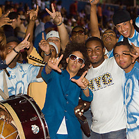 10 january 2006: Fans of Baseball team Licey pose showing the L sign (for Licey) at Estadio Quisqueya, Santo Domingo, Dominican Republic.
