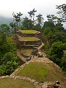 """Tourists and military officials enjoy the ruins of the """"Lost City"""" in the in Sierra Nevada - Ciudad Perdida - Colombia"""