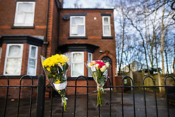 © Licensed to London News Pictures. 29/12/2020. Manchester , UK. Flowers at the scene where three people were found dead in unexplained circumstances last night (28th December 2020) at a house on Oldham Road in Failsworth, North East Manchester. Photo credit: Joel Goodman/LNP