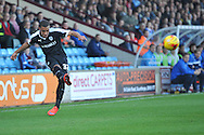 Reece Wabara of Barnsley FC crosses the ball during the Sky Bet League 1 match between Scunthorpe United and Barnsley at Glanford Park, Scunthorpe, England on 31 October 2015. Photo by Ian Lyall.