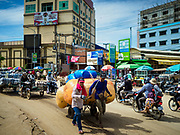 05 JULY 2017 - POIPET, CAMBODIA:  Traffic in Poipet, Cambodia. Poipet is the busiest border crossing between Thailand and Cambodia and where most of the Cambodian migrant workers going to Thailand start their journeys. The Thai government proposed new rules for foreign workers recently. The new rules include fines of between 400,000 and 800,00 Thai Baht ($12,000 - $24,000 US) and jail sentences of up to five years for illegal workers and people who hire illegal workers. Hundreds of companies fired their Cambodian and Burmese workers and tens of thousands of workers left Thailand to return to their countries of origin. Employers and human rights activists complained about the severity of the punishment and sudden implementation of the rules. On Tuesday, 4 July, the Thai government suspended the new rules for 180 days and the Cambodian and Myanmar governments urged their citizens to stay in Thailand, but the exodus of workers continued through Wednesday.    PHOTO BY JACK KURTZ