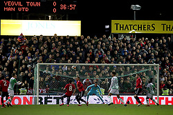 A general view of the match action with the scoreboard in the background during the Emirates FA Cup, fourth round match at Huish Park, Yeovil.