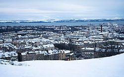 Edinburgh, Scotland, UK. 21 January 2020. Storm Christoph brought overnight snow to Edinburgh. Pic; View from  Calton hill towards snow covered roofs in Leith.  Iain Masterton/Alamy Live News