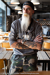 Tattoo master and face of the Ace Cafe Luzern, Huevo on a visit to the Ace after the Swiss Moto show. Switzerland, Monday, February 25, 2019. Photography ©2019 Michael Lichter.