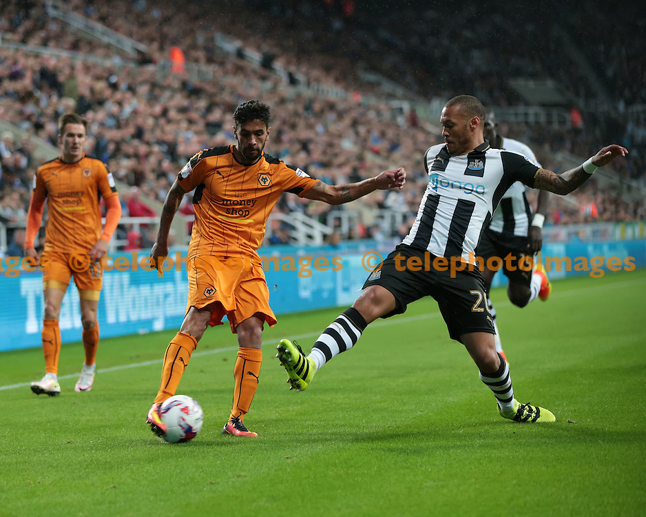 Newcastle United striker Yoan Gouffran (20) tries to block a cross from Wolverhampton Wanderers defender Silvio Sa Pereira  (3) during the EFL Cup Third Round match between Newcastle United and Wolverhampton Wanderers at St. James' Park in Newcastle. September 20, 2016.<br /> Nigel Pitts-Drake / Telephoto Images<br /> +44 7967 642437