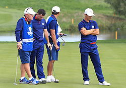 Team Europe's Rory McIlroy (centre left) and Thorbjorn Olesen stand dejected with their caddies during the Fourballs match on day one of the Ryder Cup at Le Golf National, Saint-Quentin-en-Yvelines, Paris.
