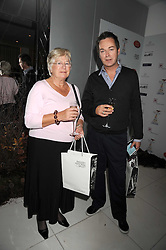 JULIAN CLARY and his mother BRENDA CLARY at a reception before the launch of the English National Ballet Christmas season launch of The Nutcracker held at the St,Martins Lane Hotel, London on 5th December 2008.