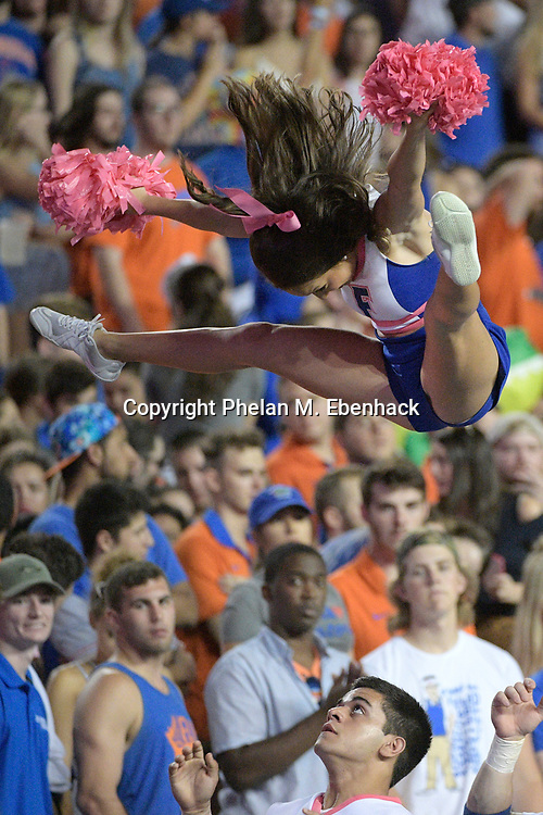 Florida cheerleaders perform on the sideline during the second half of an NCAA college football game against Texas A&M Saturday, Oct. 14, 2017, in Gainesville, Fla. Texas A&M won 19-17. (Photo by Phelan M. Ebenhack)