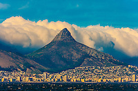 Strong winds blowing huge clouds over Lion's Head Mountain, Cape Town, South Africa.