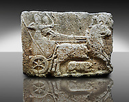 Picture & image of a Neo-Hittite orthostat with a chariot Releif sculpture from Karkamis,, Turkey.  The Cahiot is pulled by horses with plumed headresses. One man os about to shoot an arrow from his bow, the other man is driving the cahriot. Below the horse is a animal cowering. An Ankara Museum of Anatolian Civilizations exhibit.