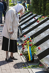 April 26, 2018 - Kiev, Ukraine - Old woman prays in the memorial of the dead Chernobyl workers during the celebrations in Kiev of the 32nd anniversary of the Chernobyl  nuclear accident, Ukraine. (Credit Image: © Celestino Arce/NurPhoto via ZUMA Press)
